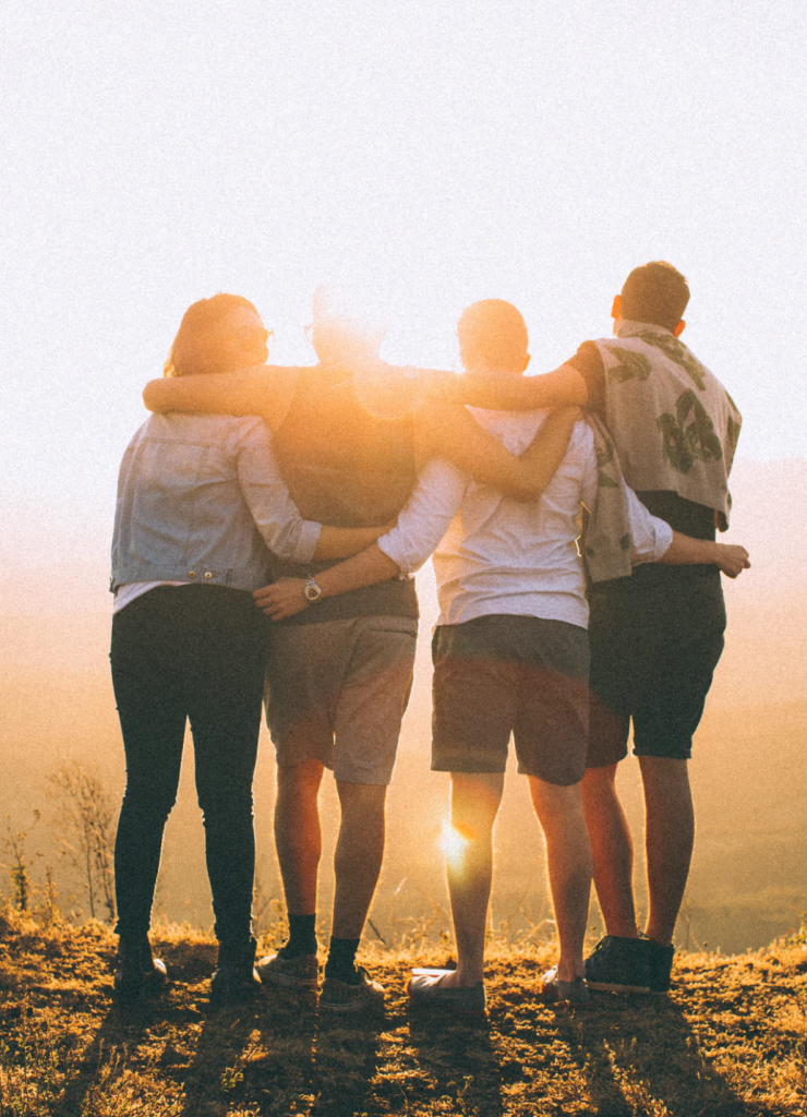 Image of four friends on a mountaintop