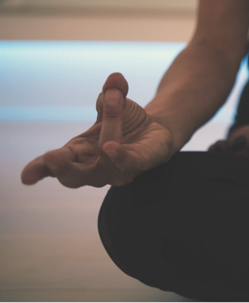 Image of the hand from a meditating woman
