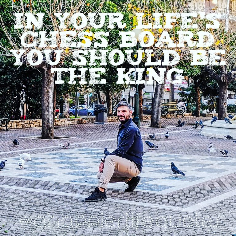 Harry kneeling in a chess board in the park with text reading 'In your life's chess board, you should be the King'